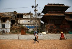 A man walks past a UNESCO world heritage site in Kathmandu, Nepal