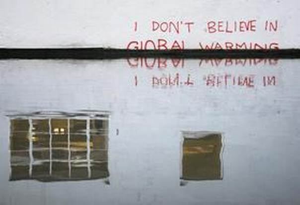 Graffiti art is seen on a wall next to the Regent's Canal, in Camden in London December 22, 2009. Climate change is one of the areas highlighted in a new report by the Council on Foreign Relations as lacking in international cooperation. REUTERS/Luke MacGregor