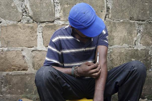 A drug user injects heroin at a construction site in Stone Town Zanzibar, in 2009. REUTERS/Katrina Manson