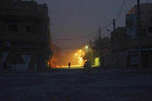 A man walks along a deserted street in Deir al-Zor April 8, 2013. Picture taken April 8, 2013. REUTERS/ Khalil Ashawi