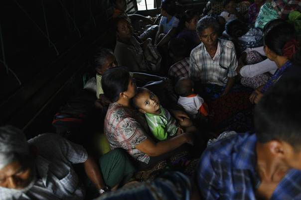 Muslims sit in a military truck as they escape to a safe place after a riot between Muslims and Buddhists in Lashio township, Myanmar, May 30, 2013. REUTERS/Soe Zeya Tun
