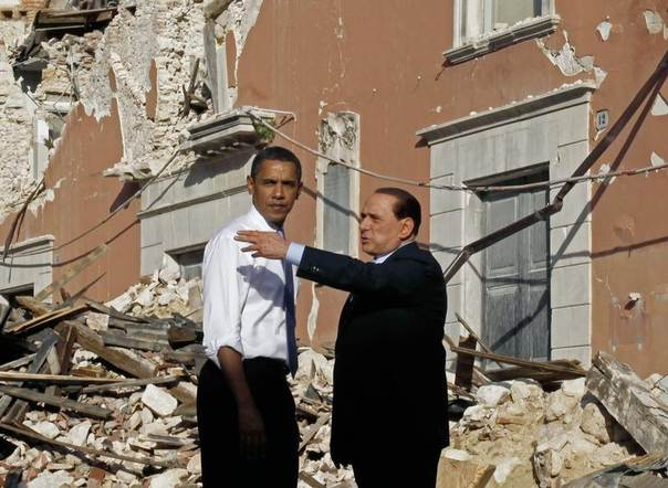 U.S. President Barack Obama tours the earthquake-hit Italian town of L'Aquila with Italian Prime Minister Silvio Berlusconi, near the site of the annual G8 Summit July 8, 2009. REUTERS/Jason Reed