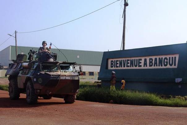 French soldiers stand guard in an armored vehicle outside M'poko international airport in Bangui March 28, 2013 REUTERS/Alain Amontchi