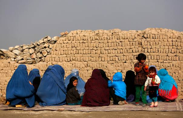 Women and children arrive for treatment at a mobile clinic in Kabul on December 17, 2013. REUTERS/Mohammad Ismail