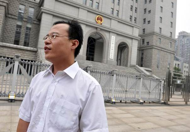 In this 2009 file photo, lawyer Hao Junbo stands outside a court in Beijing REUTERS/Stringer