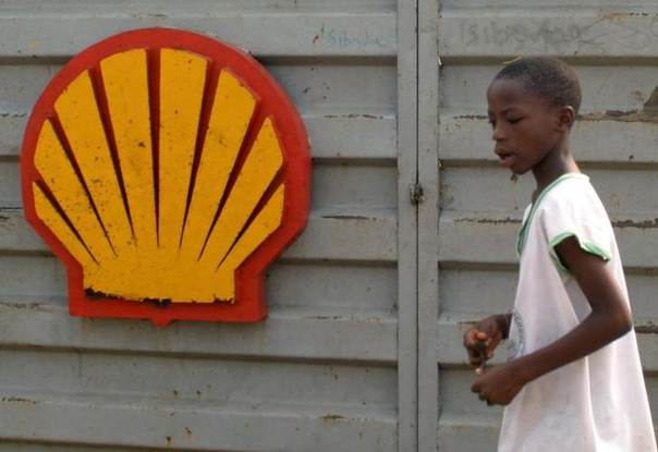 In this 2006 file photo, a Nigerian schoolboy walks past the logo of Dutch oil giant Shell near Warri in the volatile Niger-Delta region REUTERS/George Esiri