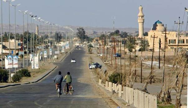 In this file photo, boys ride their bikes down a deserted main street in the northern Iraqi city of Baiji, 210 km (130 miles) north of Baghdad REUTERS/Bob Strong