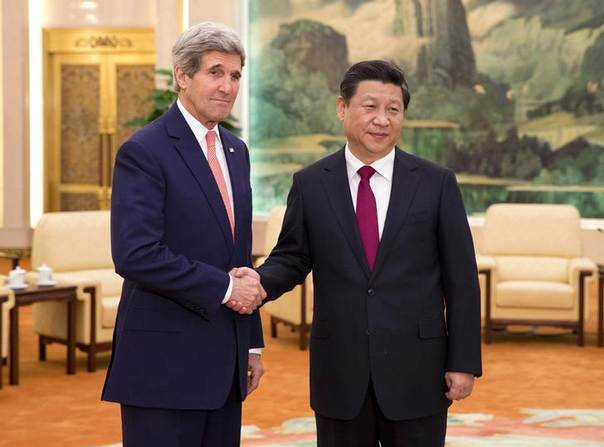 U.S. Secretary of State John Kerry (L) shakes hands with Chinese President Xi Jinping at the Great Hall of the People in Beijing February 14, 2014. REUTERS/Evan Vucci/Pool