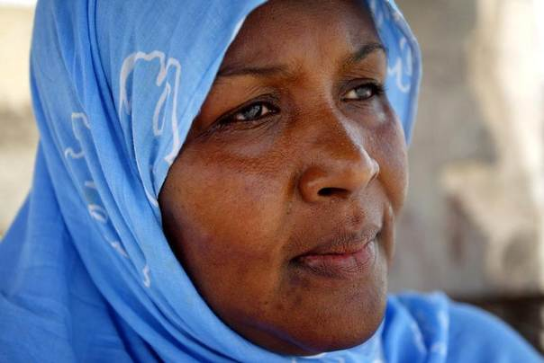 Mauritanian writer Nene Drame, who wrote a novel about force-feeding, poses for a portrait in the capital Nouakchott. Picture taken August 12, 2005. REUTERS/Finbarr O'Reilly