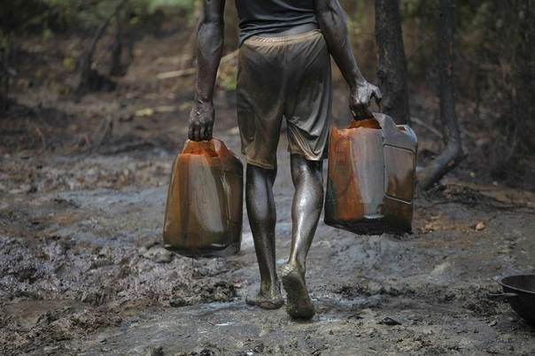 A man works at an illegal oil refinery site near river Nun in Nigeria's oil state of Bayelsa November 27, 2012. REUTERS/Akintunde Akinleye