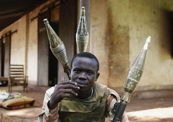 A Seleka fighter smokes in a Seleka base in Grimari May 31, 2014. REUTERS/Goran Tomasevic