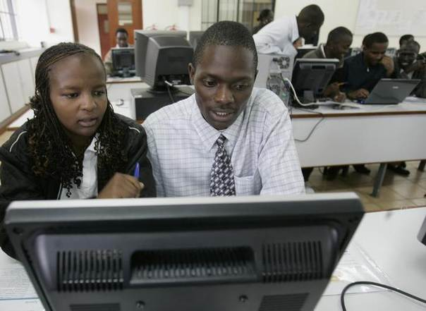 In this 2008 file photo, Nairobi University students study with computers in Nairobi REUTERS/Antony Njuguna (KENYA)