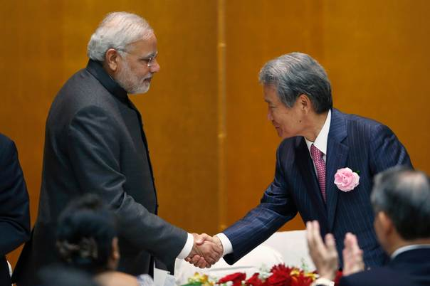India's Prime Minister Narendra Modi (L) shakes hands with chairman of Japan Business Federation (Keidanren) Sadayuki Sakakibara after Modi spoke during a luncheon organized by the Japanese Business Federation (Keidanren) in Tokyo, on Sept. 1, 2014. Japan aims to double its direct investment in India in five years from some $2 billion last year, the Nikkei business daily reported. REUTERS/Yuya Shino