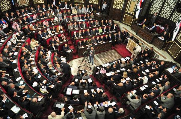 Members of the Syrian parliament attend a session to set a date for voting for the presidential election, in Damascus April 21,2014, in this handout photograph released by Syria's national news agency SANA REUTERS/SANA/Handout via Reuters