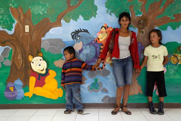 In a 2010 file photo, Alba, a 38-year-old with HIV since 2003 and mother of four boys who do not have HIV, stands with two of her sons inside the Integral Attention Center of Escuela hospital in Tegucigalpa, Honduras. REUTERS/Edgard Garrido