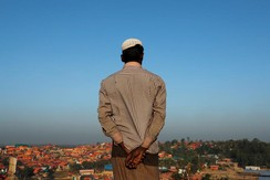 A Rohingya refugee looks at the view from a hill at Palong Khali refugee camp near Cox's Bazar, Bangladesh