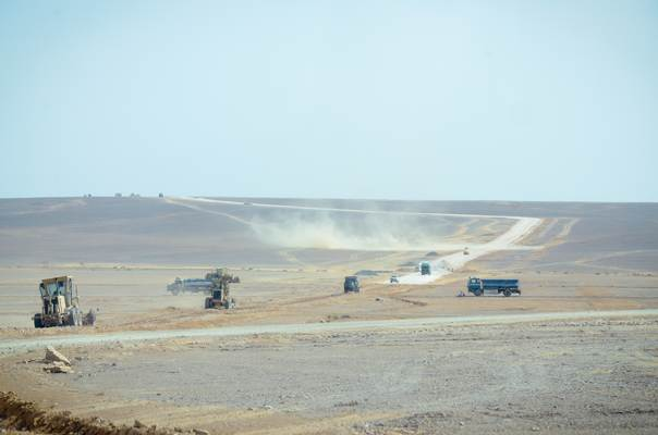 At the Azraq refugee camp site in Jordan, work begins laying roads on this large desert site, soon to be home to 130,000 Syrian refugees. Credit: Mike Bailey/World Vision