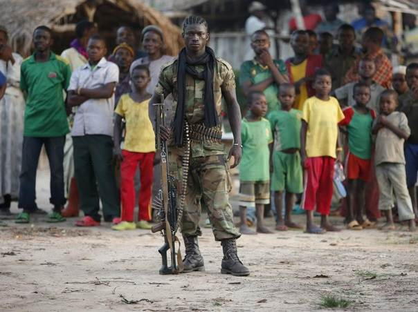 A Seleka fighter stands in a village close to the border of the Democratic Republic of Congo, in Central African Republic, June 10, 2014. REUTERS/Goran Tomasevic