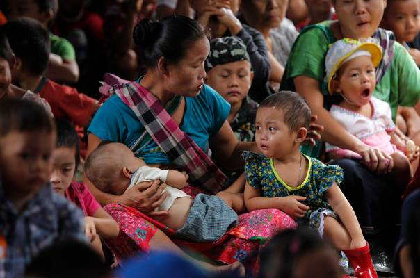 Refugees who fled Myanmar wait for the Thai authorities to conduct a census at Mae La refugee camp, near the Thailand-Myanmar border in Mae Sot district, Tak province, on July 21, 2014. Thai authorities have started the census to crack down on illegal workers, raising fears among the refugees of an imminent repatriation to Myanmar. Thailand's military government said last Monday it would send home 100,000 refugees who have been living in camps for two decades and more along the border with Myanmar, a move rights groups say would create chaos at a tense time for both nations. REUTERS/Chaiwat Subprasom