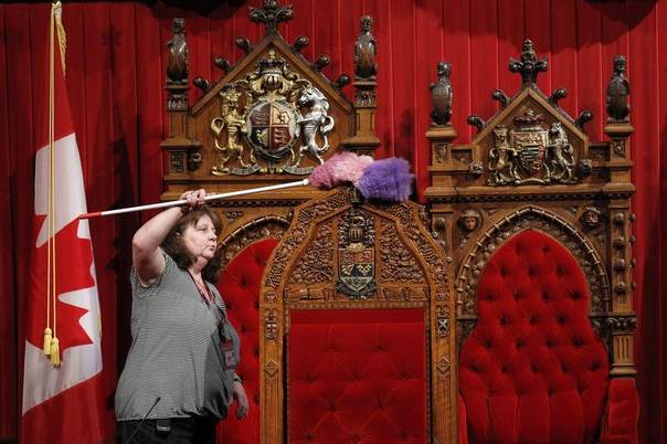 A worker cleans the Senate chamber on Parliament Hill in Ottawa September 16, 2010. REUTERS/Chris Wattie