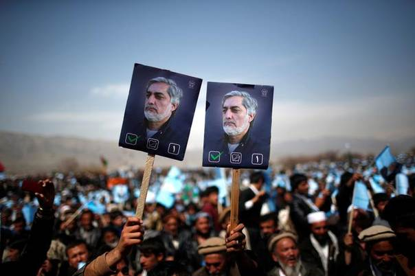 Supporters of Afghan presidential candidate Abdullah Abdullah hold posters of him during an election rally in Parwan province, northern Afghanistan, March 20, 2014. REUTERS/Ahmad Masood