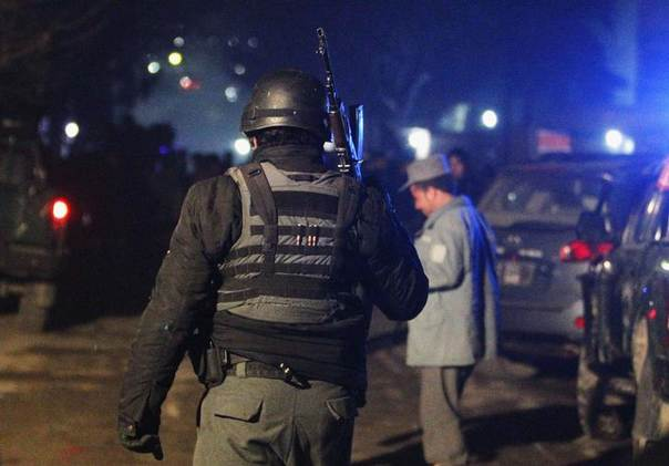 An Afghan police officer arrives at the scene of an explosion in Kabul, Afghanistan, January 17, 2014. REUTERS/Omar Sobhani