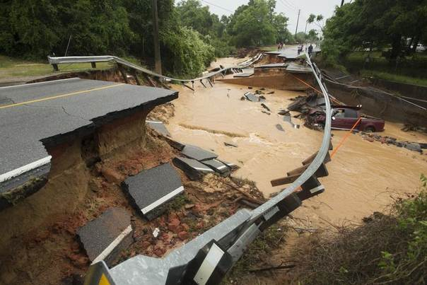 Damage due to flash flooding is seen along Johnson Ave. in Pensacola, Florida, April 30, 2014. REUTERS/Michael Spooneybarger