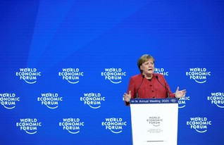 Merkel urges dialogue between skeptics and believers to tackle climate change