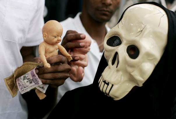 In a file photo from 2007, residents hold dolls symbolising babies and foetuses during a protest against abortion on the streets of Santo Domingo. REUTERS/ Eduardo Munoz