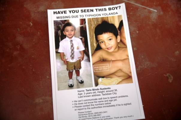 Poster asking for the whereabouts of Tarin Sustento, a three-year-old boy who's been diagnosed as mildly autistic and who was separated from his family on the morning of Nov. 8, 2013 when Typhoon Haiyan hit Tacloban. Photo taken Jan 30, 2014. THOMSON  REUTERS FOUNDATION/Thin Lei Win