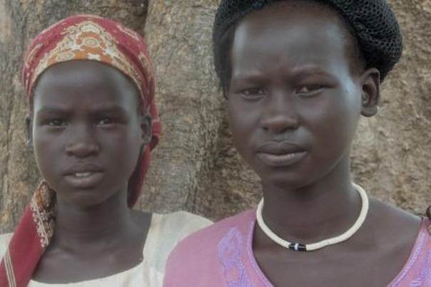 Nyamoch and Nyagonar lost their 7-year-old sister as they fled the violence. Photo: Alder/CARE
