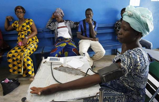 A woman has her blood pressure checked at a health centre in Gbangbegouine village, western Ivory Coast, July 4, 2013. The European Commission and UNICEF promised aid of 6.5 million euros to help reduce maternal and child deaths in the country. REUTERS/Luc Gnago
