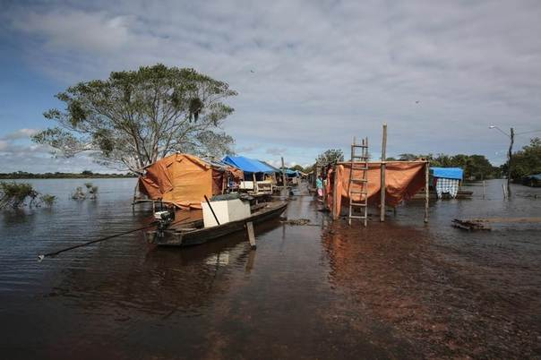 An abandoned camp is pictured amid a flood in Puerto Varador in Trinidad in Bolivia's northeast, Feb. 28, 2014. REUTERS/David Mercado