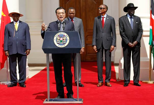 Chinese Premier Li Keqiang is flanked by Uganda's President Yoweri Museveni (L), Kenya's President Uhuru Kenyatta (3rd R), Rwanda's President Paul Kagame (2nd R) and Salva Kiir, President of South Sudan, as he addresses a news conference after the signing of the Standard Gauge Railway agreement at the State House in Nairobi, on May 11, 2014. Li pledged