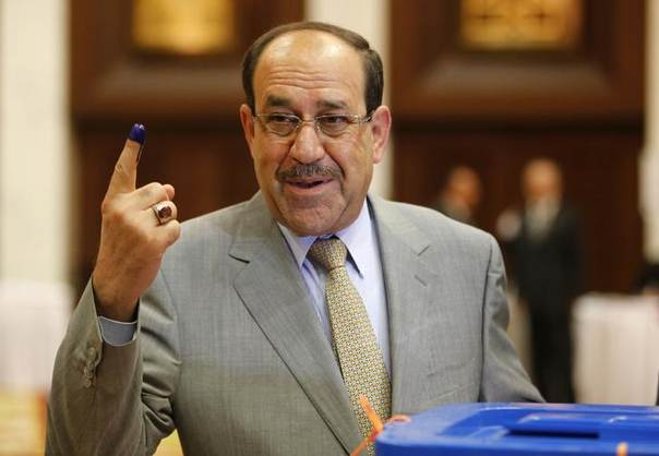 Iraq's Prime Minister Nuri al-Maliki shows his ink marked finger as he votes during parliamentary election in Baghdad April 30, 2014.  REUTERS/Ahmed Jadallah