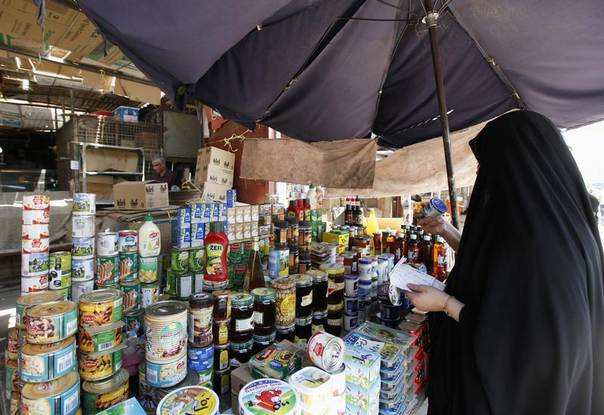 A woman shops ahead of the Muslim fasting month of Ramadan at the Shorja wholesale market in central Baghdad, Iraq, June 28, 2014. REUTERS/Ahmed Saad
