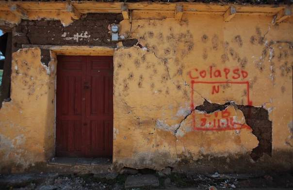 A damaged house is marked for demolition by rescue authorities after the earthquake that struck in San Marcos, in the San Marcos region, about 250 km (155 miles) from Guatemala City, November 9, 2012. REUTERS/William Gularte