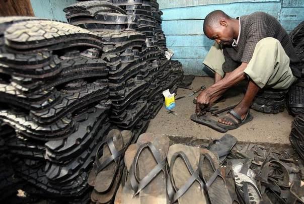 A man makes footwear from tyres near the Kenyan capital. African countries are following the lead of Asia, where millions of people have obtained small loans thanks to an explosion of microfinance operations. REUTERS/Antony Njuguna