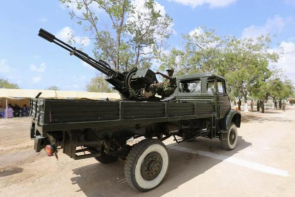 A military truck mounted with an anti-aircraft gun drives past during celebrations to mark the 54th anniversary of the Somali National Armed Forces, in the capital Mogadishu April 12, 2014. REUTERS/Feisal Omar