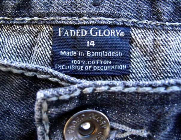 The tag on a pair of jeans by Wal-Mart's brand Faded Glory, which is made in Bangladesh, is shown after purchase from a Wal-mart store in Encinitas, California, on May 14, 2013. Wal-Mart said it would conduct in-depth safety inspections at all 279 Bangladesh factories with which it works and publicly release the names and inspection information. REUTERS/Mike Blake