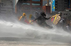 Opposition supporters clash with riot security forces in Caracas, Venezuela