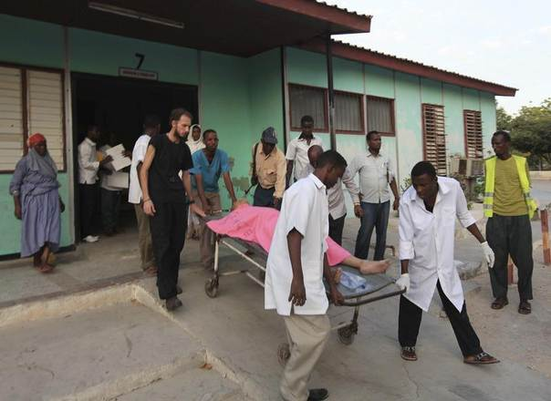 This photo from December 2011 shows Madina hospital staff helping an injured Medecins Sans Frontieres (MSF) worker south of the capital Mogadishu. REUTERS/Feisal Omar