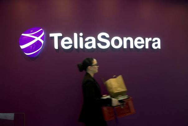 A woman walks past TeliaSonera's logo during the company's fourth quarter result presentation January 31, 2013 REUTERS/Fredrik Sandberg/Scanpix