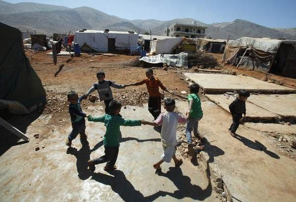 Syrian refugee children play at a camp in Terbol in the Bekaa Valley in Lebanon, July 31, 2013. REUTERS/Sharif Karim