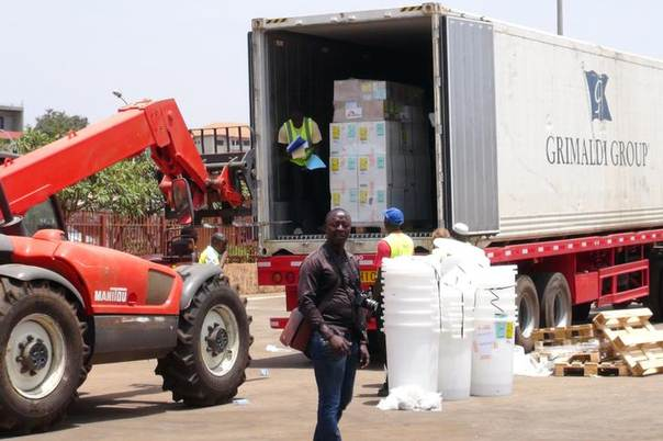 Workers from Doctors Without Borders unload emergency medical supplies to deal with an Ebola outbreak in Conakry, Guinea, March 23, 2014. REUTERS/Saliou Samb