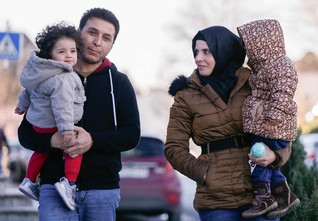 INSIGHT- Syrian refugees must buy travel papers - from Assad