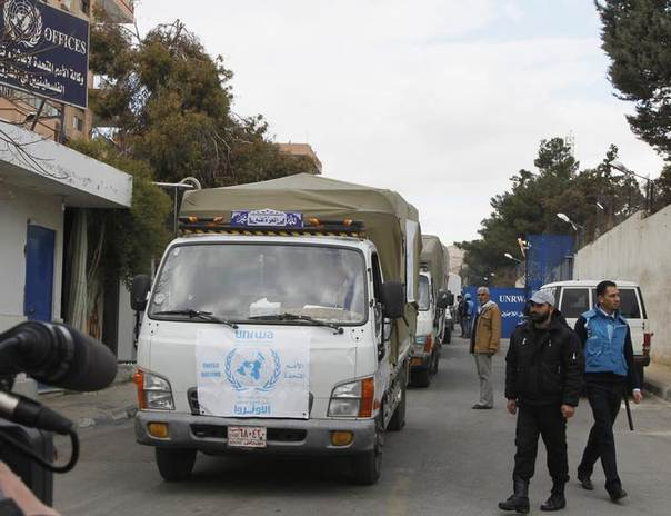 Trucks carrying food aid from UNRWA make their way to the besieged camp of al-Yarmouk, south of Damascus, which is controlled by opposition fighters, Syria, January 13, 2014. REUTERS/Khaled al-Harir