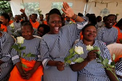 Inmates receive roses for Valentine's Day at the Langata Women Maximum Security Prison in Nairobi, Kenya