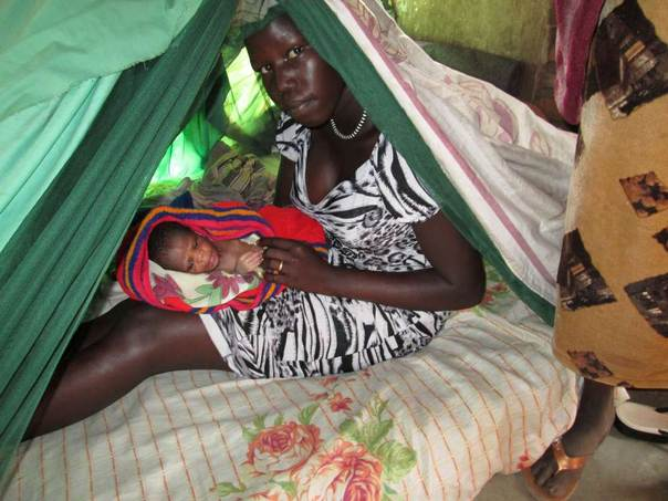 young mother with her baby who has fled violence and is taking refuge in Nimule, near the Ugandan border. Photo: CARE