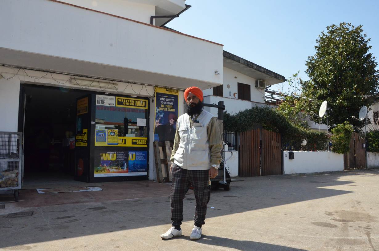 Gurmukh Singh, head of an Indian community association in Rome's Lazio region, stands outside his shop in Borgo Hermada, Latina, Italy. March 25, 2017. Thomson Reuters Foundation/Umberto Bacchi